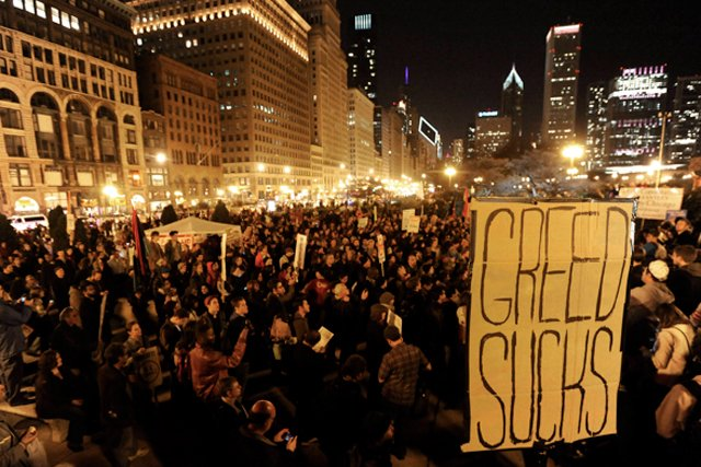 Greed sucks, capitalism sucks, income inequality sucks, having no public safety sucks, hobos who don't give back to the movement suck..... Picture courtesy of Washington Post, which does not suck because we're taking this pic off their site for free.