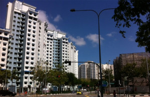 Workers' Party blue flats (left) and the bomb site Rivervale Plaza (right.)