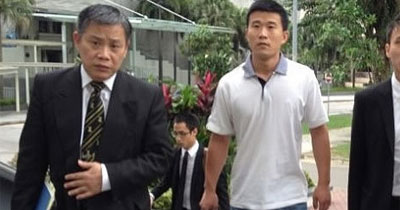 From left: Lawyer, ex-SMRT driver who won the free staycation and Choo Zheng Xi. (Photo stolen from Yahoo!)