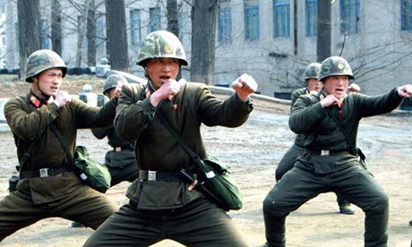 """North Korean soldiers appear to be mocking """"Gangnam Style"""" in a propaganda picturePhotograph: AFP/KNS"""
