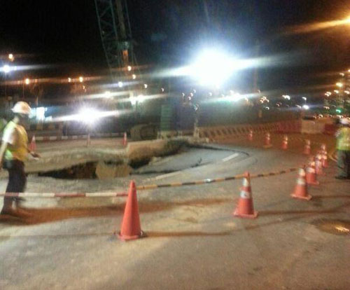 Area has been sealed off as trucks containing Jollibee have been unloaded into the sinkhole.